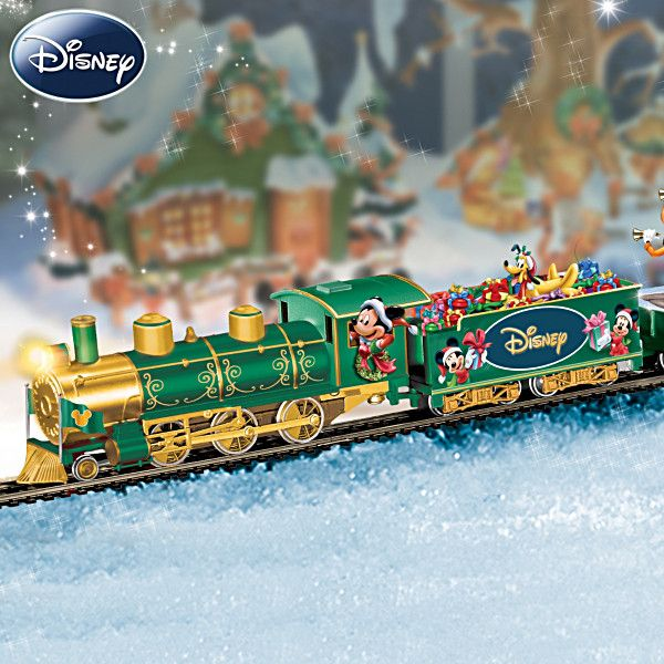 "Lighted Disney Holiday Celebration Express Train Collection Disney Holiday Celebration Express Train Collection  Illuminated handcrafted On30-scale electric train with fully sculpted, removable scenes of Disney friends. FREE track and power pack, a $100 value.  Complete oval track measures 47"" x 38""  From Hawthorne Village  Price:     $75"