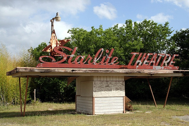 Starlite drive-in theatre sign opened in 1950. This was an all year operating drive-in theater that had an 860 car capacity.  Since closing it has been used as a swap-meet. The screen was demolished in 1997 but the Art Deco style roadside marquee still stands in El Monte, CA.