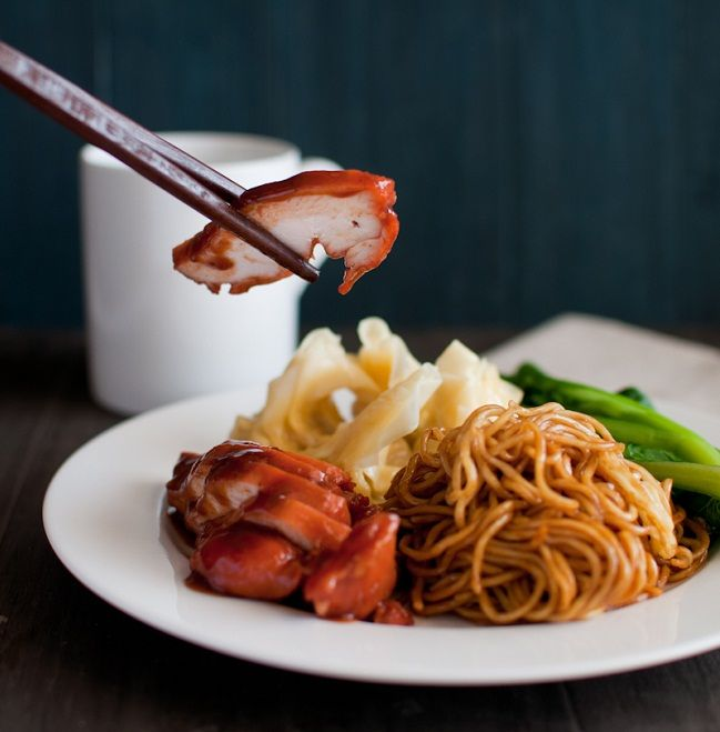 A typical Malaysian breakfast dish, stir-fried noodles are coated in a sticky sauce and served with steamed greens, a side of wontons (Wantans) and barbecued pork or chicken (Char Siew).
