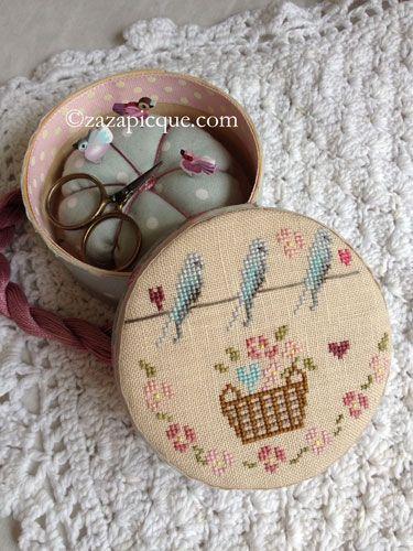 cross stitch bird box with a pincushion inside