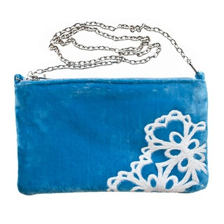 This fabulous evening bag is made from luxurious velvet and has an elegant, fine shoulder chain that adds a touch of glamour to any occasion.