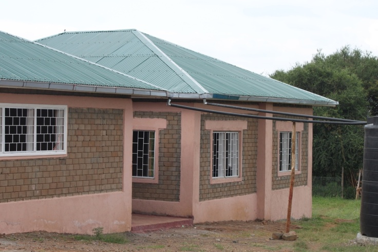 In June 2010 a generous donor from the UK by the name of John D. offered to build a kitchen & administration building for EBCCK.  Construction started in August with the use of the hydraform machine to make the bricks for both buildings.   The Girl's dorm was the model we used since it was highly economical and successful in construction.
