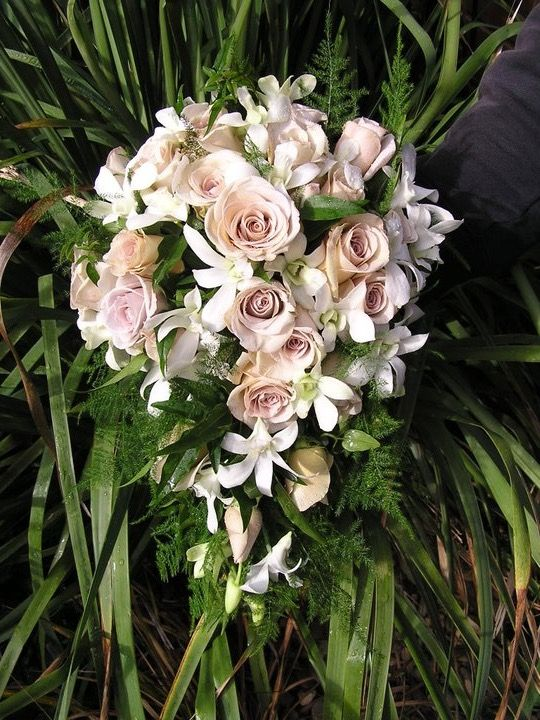 Latte roses and ivory singapore orchids- trailing bouquet @weddingflowersetc.com