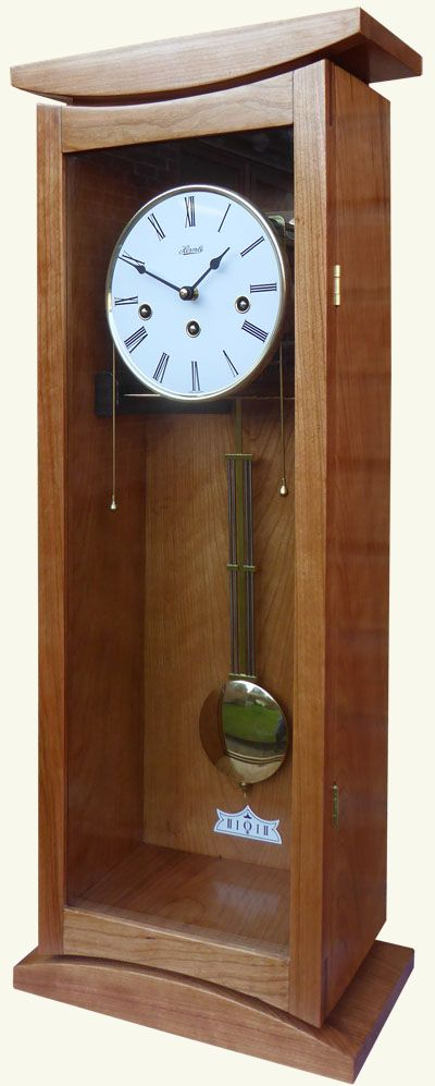 Camlarg - Small Wall Clock  elegant and contemporary looking small regulator style wall clock. The cabinet is handcrafted from locally sourced, sustainable hardwoods; finished with Danish oil and Bees wax to produce a delightful quality sheen and pleasing tactile feel.   The clock is fitted with a Hermle 341 - spring driven eight day clock movement, which has automaticatic night silence. It plays the Westminster chime with a melody on the 1/4, 1/2 & 3/4 hour marks.