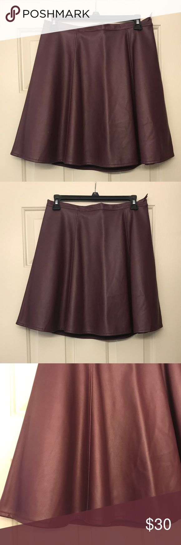 Plum faux leather skater skirt Super trendy Plum colored faux leather skater skirt. Secures with a zipper and a button on the side. Never worn! LC Lauren Conrad Skirts Circle & Skater