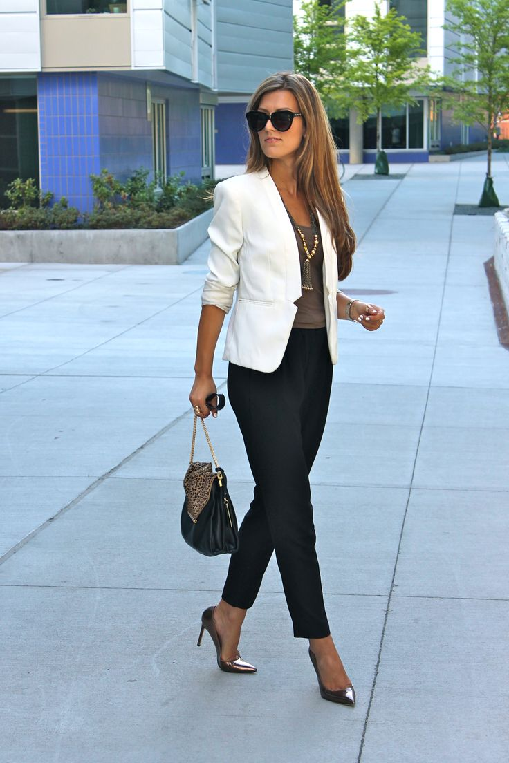 White blazer, black pants, brown top, splash of leopard