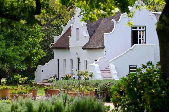 #CapeDutch #Farmhouse, beautiful details.  I love the way it sits in the gardens and the staircase shapes.