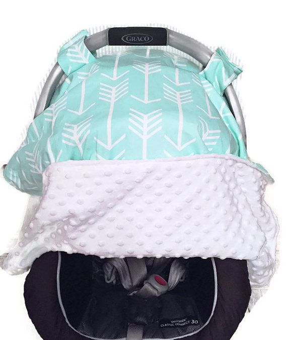 This is luxurious gender neutral baby carseat canopy. It is a mint arrow printed carseat canopy, carseat cover! Carseat canopies/covers are amazing for