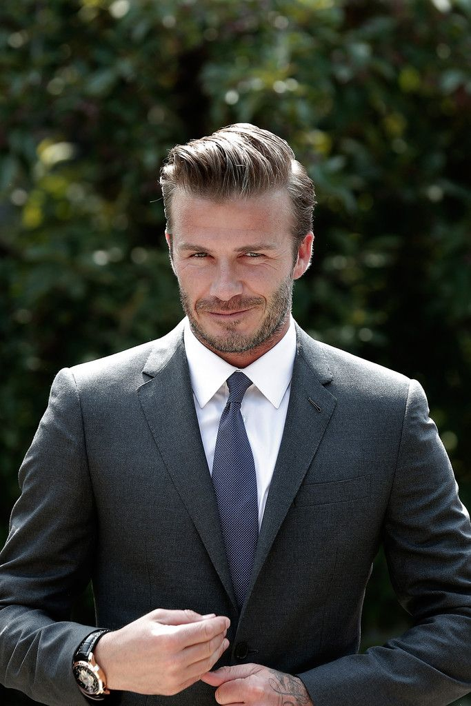 David Beckham attends Chinese football charitable donation ceremony at Soong Ching Ling's Former Residence on June 17, 2013 in Beijing, China. Beckham has donated his jersey and his wife Victoria Jaguar F-Type Sport car to the Soong Ching Ling Foundation to sell them for a charity in China.