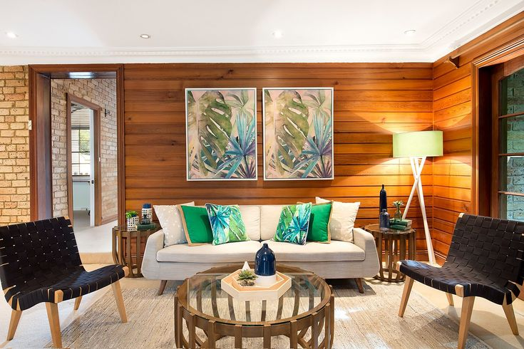 Separate lounge, wall art, exposed brick, timber panelling, floor lamp, coffee table, sitting chairs, throw cushions, two seater lounge, Pilcher Residential