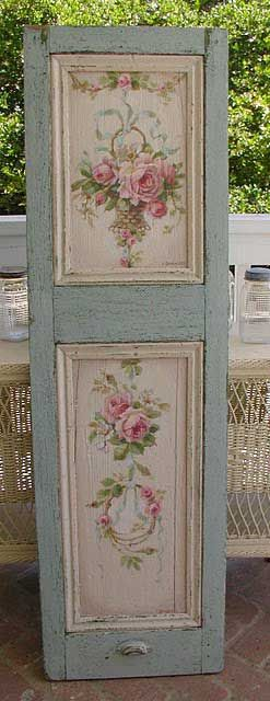 turquoise door with cabbage rose panels