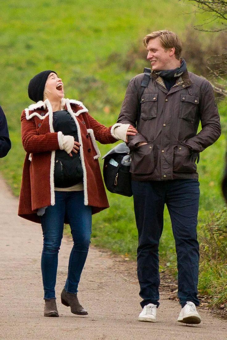 Clarke cradles a baby during a walk on Hampstead Heath