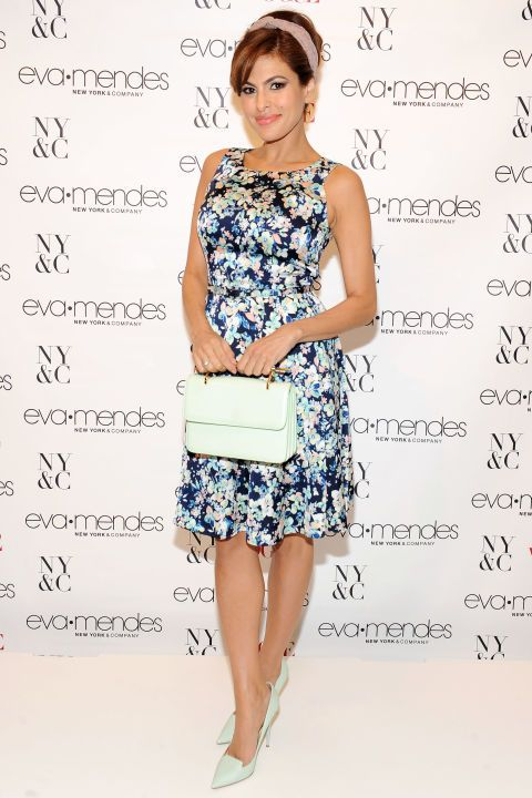 Eva Mendes in Eva Mendes Collection for New York & Company and a M2MALLETIER bag