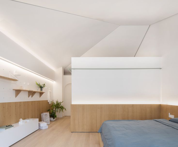 RIGI Design transformed a 1940s Shanghai into a light-filled family home with adaptable modular furniture and playful house-shaped elements.