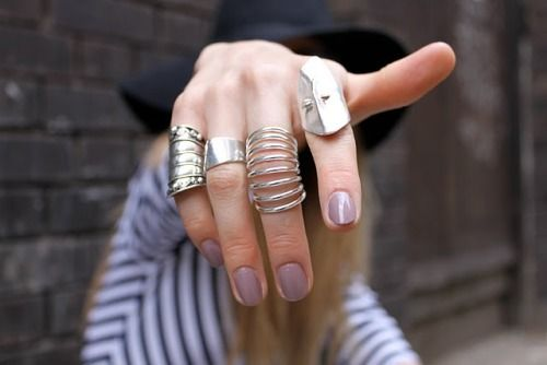Light violet nails and silver rings.