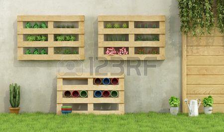 Jard n con jardineras hechas de paletas de madera reciclados Rendering 3D Foto de archivo