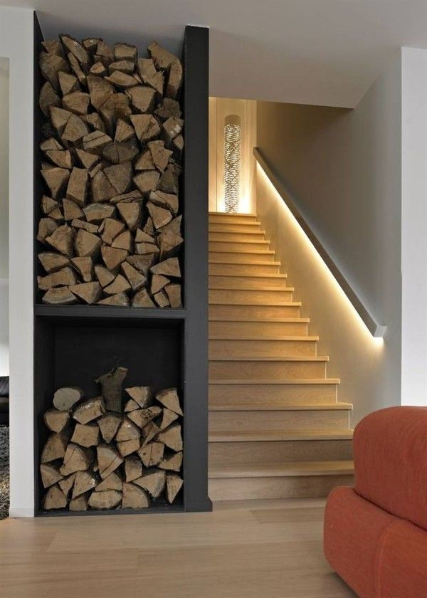 Basement stairway with LED light strip along railing