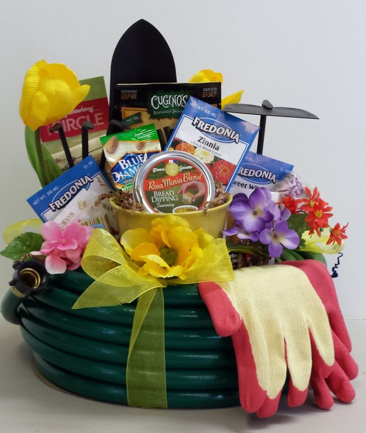 This 60' Garden Hose Basket is filled with gardening goodies both for the garden and things grown in a garden.  Can be modified into a car care basket with all the stuff for car lovers to keep a shine on their wheels!  To order yours call Express Yourself Gifts & Baskets 508.987.9875.: