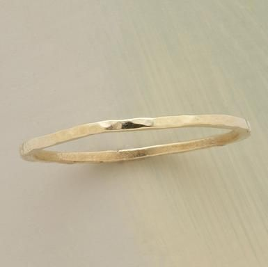 Wafer Thin Gold Band  Delicate adornment to make a simple statement. Hammered 14kt gold. Whole sizes 5 to 11.  Read Our Product Story    Read all 3 reviews | Write a review  #30584 Wafer Thin Gold Band  $260.00