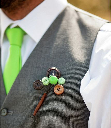 This vibrant green tie paired with this genius button boutonniere against a gray vest makes for an awesome groom's look.