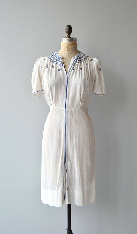 Vintage 1930s semi-sheer white gauze dress with Grecian blue embroidered neckline, little embroidered fish, puff shoulder sleeves, split hem and side snap closures.   --- M E A S U R E M E N T S ---  fits like: small/medium shoulder: 14.5 bust: 34-38 waist: up to 30 hip: up to 42 length: 39 brand/maker: Everglade | Imported Hand Detailed condition: a small hole at the upper back  to ensure a good fit, please read the sizing guide: http://www.etsy.com/shop/DearGol...
