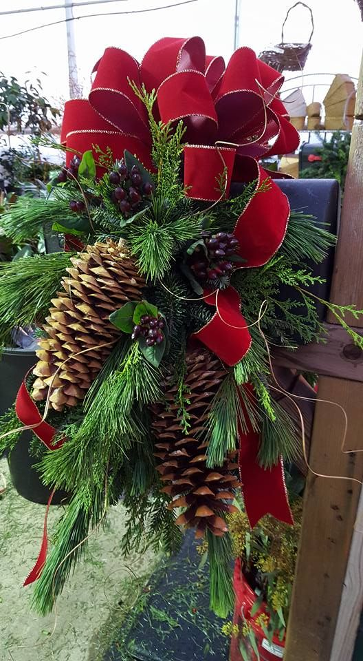 Large mailbox saddle at Andy's Creekside Nursery in Vestavia Hills, AL. Mixed greenery - Frasier fir, cedar, white pine, burgundy berries, gold ting ting, large sugar pine cones and large burgundy velvet bow with gold trim.