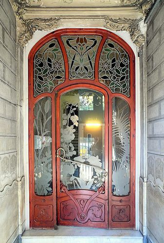 Incredible Art Nouveau doors with carved wood and stained and etched glass, in Barcelona