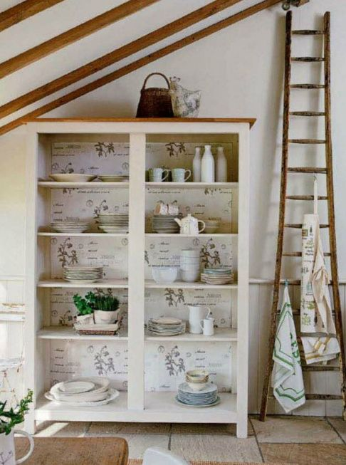 love the botanical print in the back of the cabinet