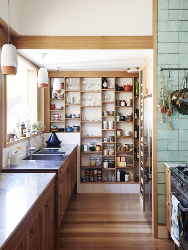 kitchen wall storage -- ideal for a tiny home. shallow shelves means nothing is hidden in the back.