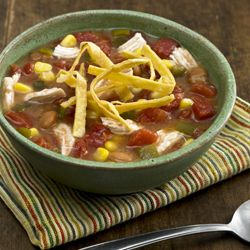 Creamy Chicken Tortilla Soup: Chicken tortilla soup recipe combines spicy tomatoes, refried beans, corn and chicken with chicken broth for a quickly prepared soup