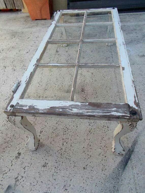 Table made from chair legs and old window.  Love!