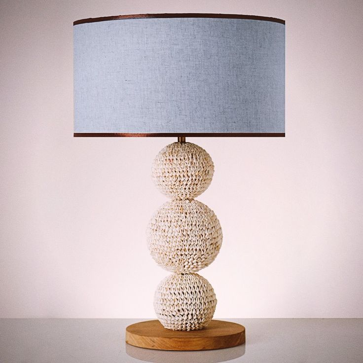 Crafted carefully from cowrie shells in the shape of 3 balls for its stand, our Diva Shell Table Lamp would definitely fit your seaside getaway. #pimentrouge #bali #lighting #lamps #homedecor #interior #design #styling #blue #harmony #bythesea #beachfront #seashore #islandlife #tropical #paradise #getaway #shells #seashells #blue #cowrie