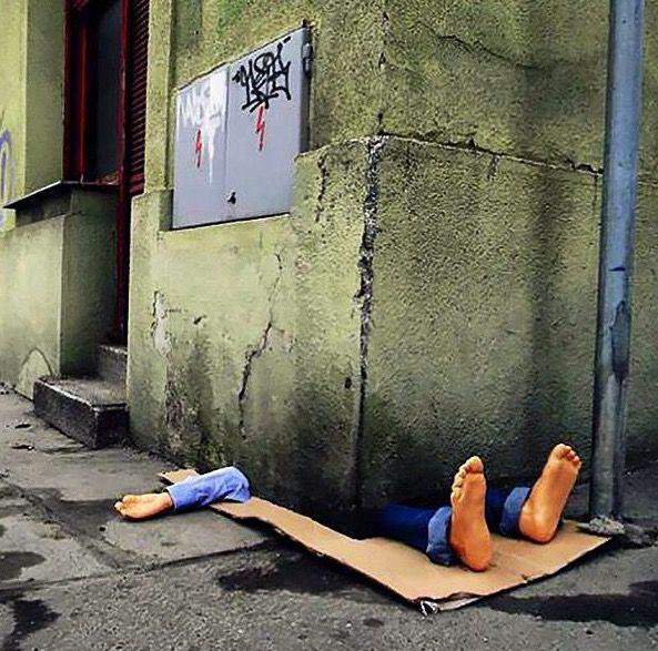 Pictured: Mystery man stuck under building corner in breathtaking street artwork