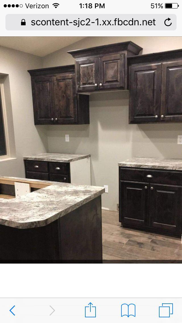 Dark cabinets with light granite and light floors dream for Dark kitchen cabinets with light granite