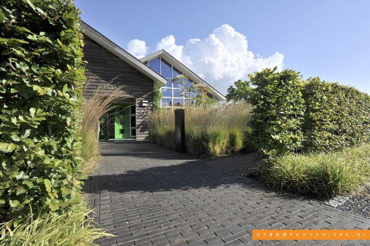 Tuin ideeën De Rooy Hoveniers bedrijfstuin grassen Dussen