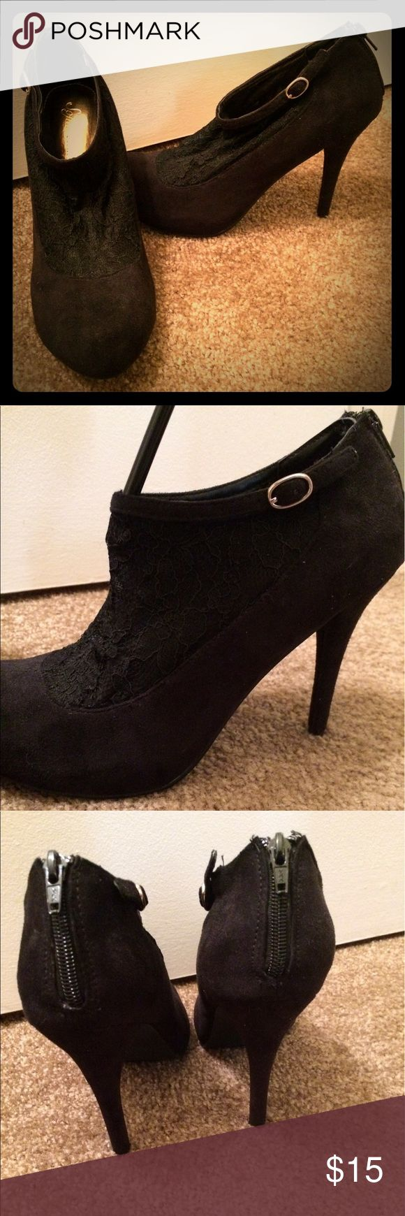Black Lace Heels w/ Buckle Like-new condition! Beautiful Lace on front of shoe, zipper on the heel to fit snug. 3 1/2-inch heel. Suede-like material on entire shoe except the Lace portion. Decorative buckle on side. Ankle-height. sofia vergara Shoes Heels