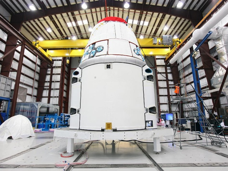 The Space Exploration Technologies, or SpaceX, Dragon spacecraft stands inside a processing hangar at Cape Canaveral Air Force Station in Florida. Teams had just installed the spacecraft's solar array fairings.    NASA and its international partners are targeting Friday, March 1, as the launch date for the next cargo resupply flight to the International Space Station by SpaceX. Launch is scheduled for 10:10 a.m. EST from Space Launch Complex 40 at Cape Canaveral Air Force Station in Florida.