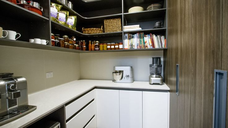 A butler's pantry was added to house small bench top appliances and provide secondary preparation + storage areas, keeping the main area free of clutter.