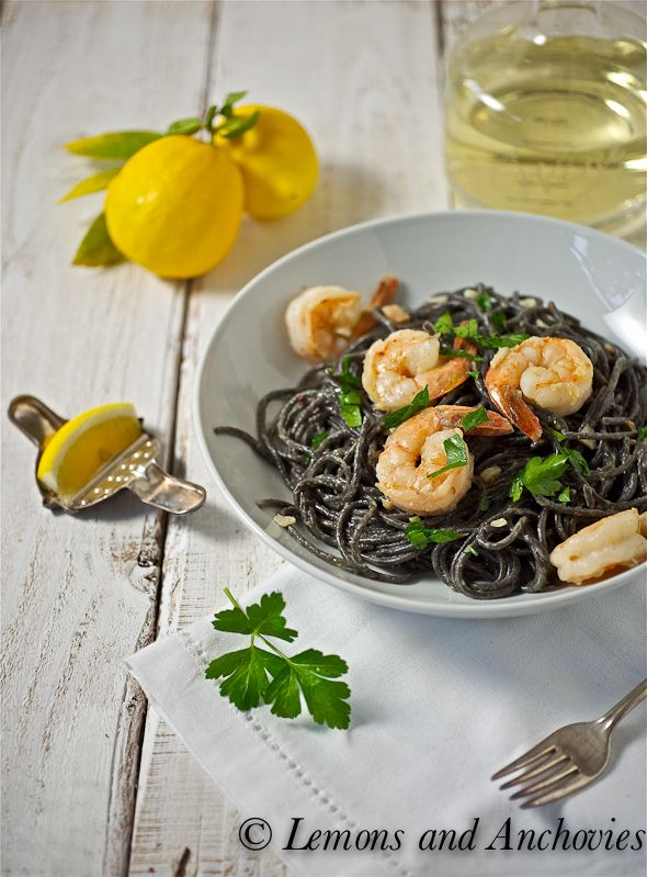 Squid Ink Spaghetti with Shrimp and White Truffle Oil - clams with juice, garlic, white wine, half and half, crushed red pepper, lemon, butter, olive oil, parsley, white truffle oil