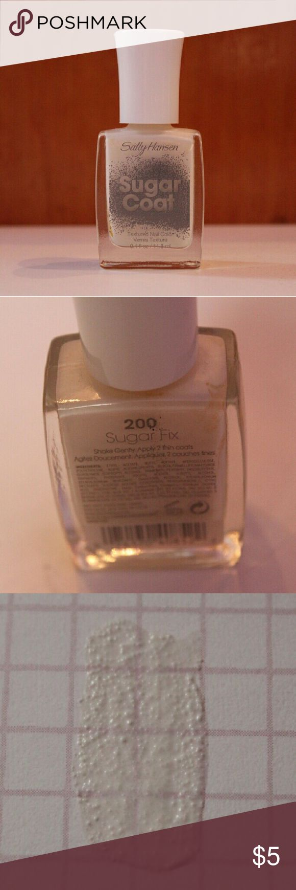 Sally Hansen Sugar Coat White Nail Polish This textured nail color gives a sugary effect to your nail. It looks great this time of year and would make your nails look snowy! Never used! Sally Hansen Other