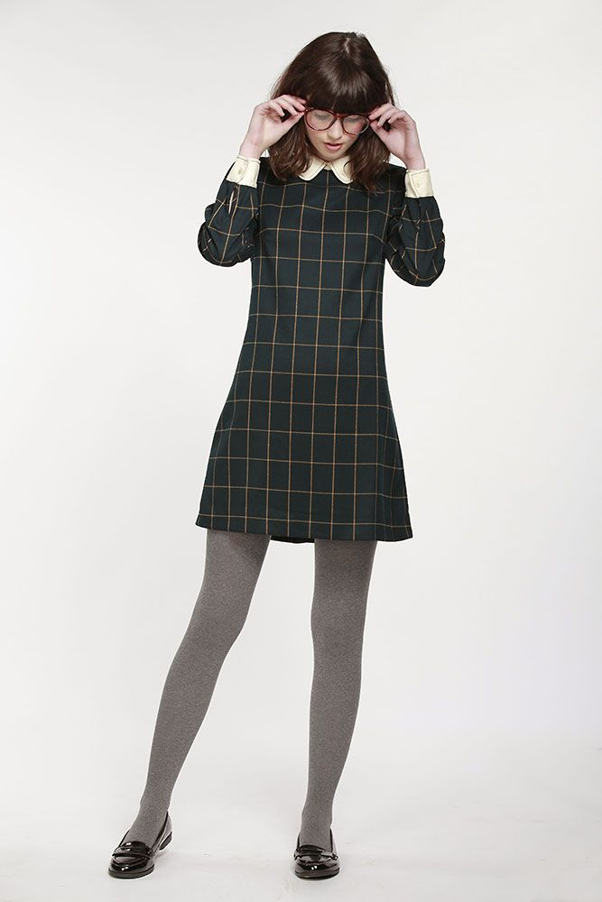 Taylor Swift Channels Her Inner Schoolgirl (& On A Budget) #refinery29  http://www.refinery29.com/2014/11/77345/taylor-swift-tartan-dress-outfit#slide2  This dress is so cooly collegiate, it'll make you want to go back to college.