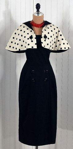 1950s vintage Pauline Trigere wiggle dress with black and white polka-dot capelet.