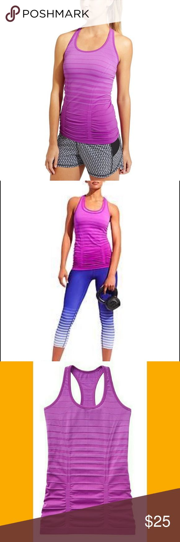 NWOT Athleta Purple Gradient Fastest Track Tank LG Your favorite, go-to training tank for high-intensity sweat sessions has our best technologies: Unstinkable, Regul8, and chafe-free seamless fabric. * Run, gym/training, studio workouts * Racerback gives you full range of arm motion * Shirring along the front and back is fit to flatter * Gripper dots along hem stop it from riding up Comes from a smoke and pet free home Item is new without tags and has never been worn My prices are firm. No…