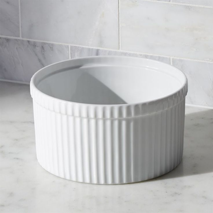 Shop Soufflé Dish.  Durable, ribbed white porcelain adds classic style to a variety of foods.  Soufflé dish is suitable for any dish with a crumb or bread topping, deep soufflés, casseroles or even gelatin creations.
