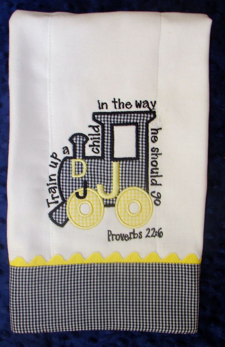Appliqued burp cloth with monogram. $8.00, via Etsy.