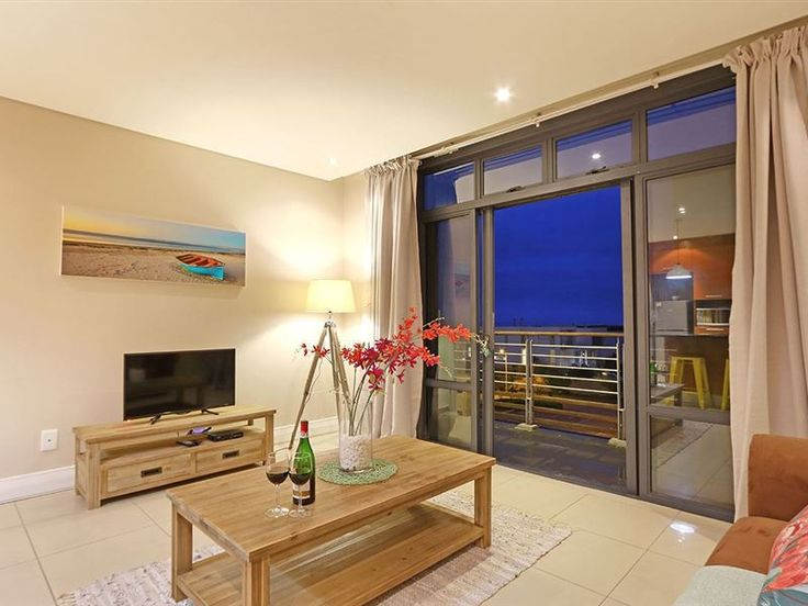 Eden On The Bay 262B - Situated in the spectacular beachside suburb of Bloubergstrand, Eden On The Bay 262B is a charming and private one-bedroom apartment ideal for couples.The main interior of the apartment, with colourful ... #weekendgetaways #bloubergstrand #capemetropole,blaauwberg #southafrica