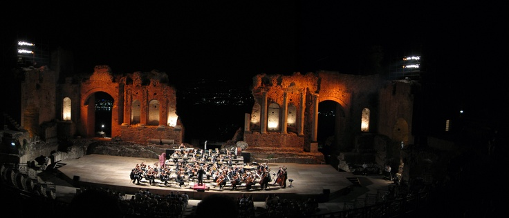 Teatro Greco, Taormina. Lava stream from active Etna in the background....beautiful, Sicily