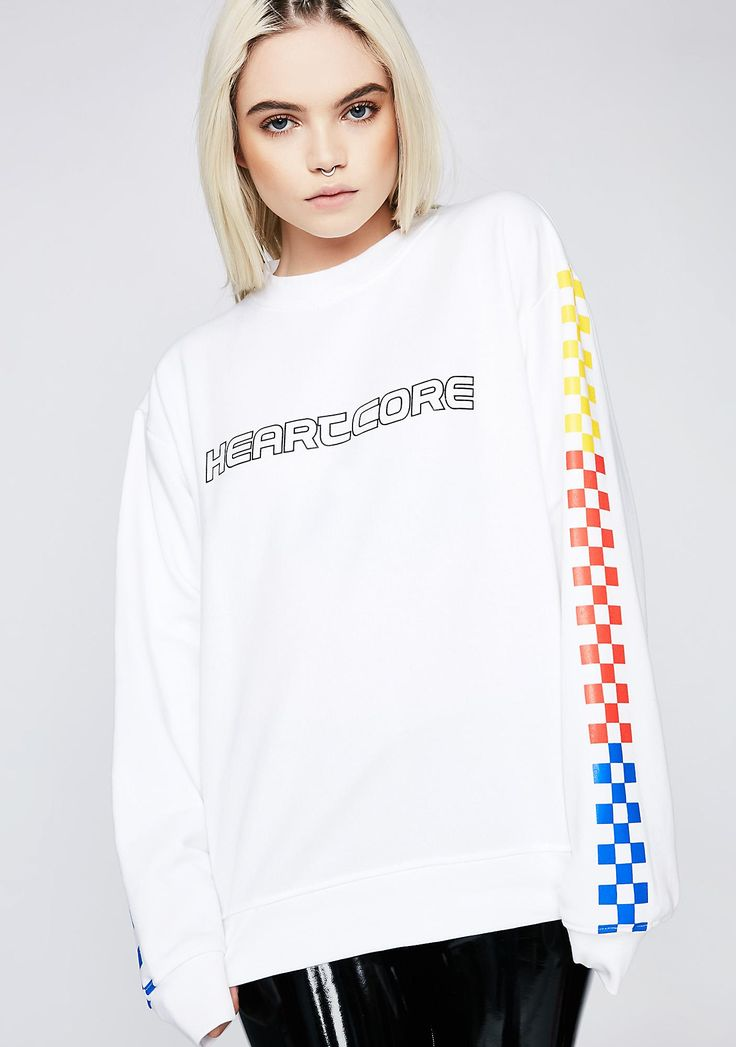 "Local Heroes Heartcore Color Checkered Sweatshirt cuz your luv is on fire. This white sweatshirt has outlined ""HEARTCORE"" text on the front and colored checker graphics on the sleeves."