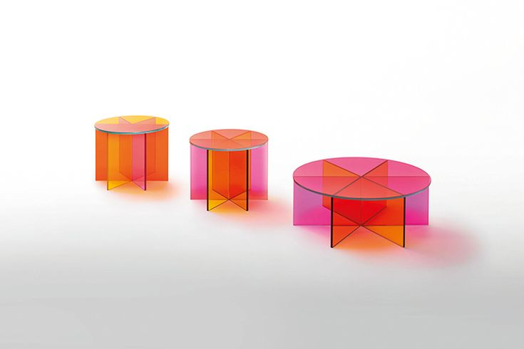 Low table realized in transparent pink, orange and yellow coloured glass. The base is obtained by gluing six laminated 6+6 mm. thick glass plates with special chamfering. The top, in laminated 6+6 mm. thick glass, leans on the base and is available in one of its three colours.