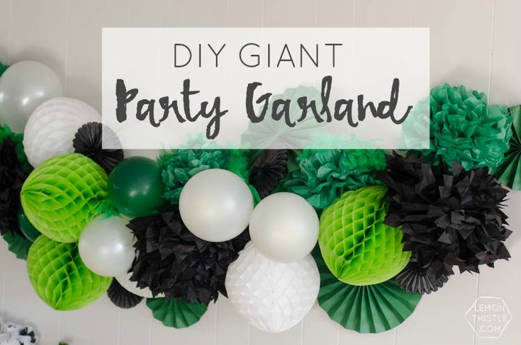 TO MAKE THIS GARLAND YOU'LL NEED: Bakers twine and darning needle (that's the big needle) Balloons (I used 4 white, 3 green) Honeycomb party balls (I used 4 green, 3 white) Tissue Paper Pouffs (I used 3 large black, 4 medium green) Pinwheels (I used 3 large green, 3 small green, and 5 small black) Feather boas (I used 2 green) Scissors and nails for hanging
